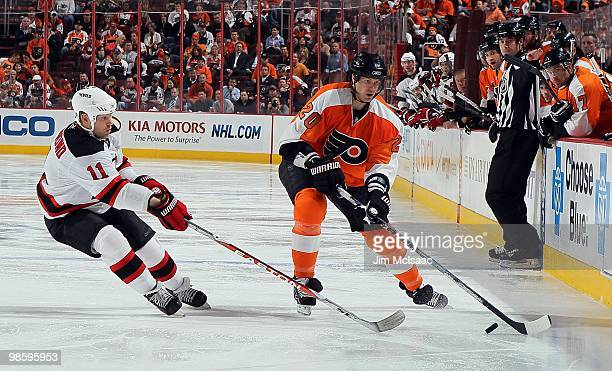 Chris Pronger of the Philadelphia Flyers skates against Dean McAmmond of the New Jersey Devils in Game Four of the Eastern Conference Quarterfinals...