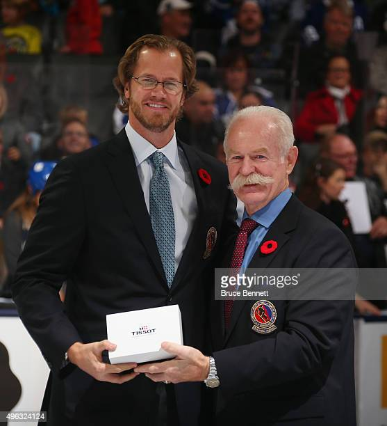 Chris Pronger receives his Hockey Hall of Fame blazer from the Chairman of the Hockey Hall of Fame Lanny McDonald prior to the Legends Classic game...