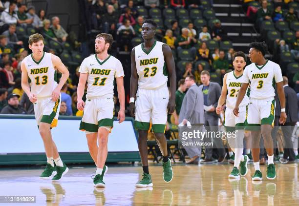 Chris Quayle Jared Samuelson Deng Geu Cameron Hunter and Tyree Eady of the North Dakota State Bison stand on the court during their game against the...