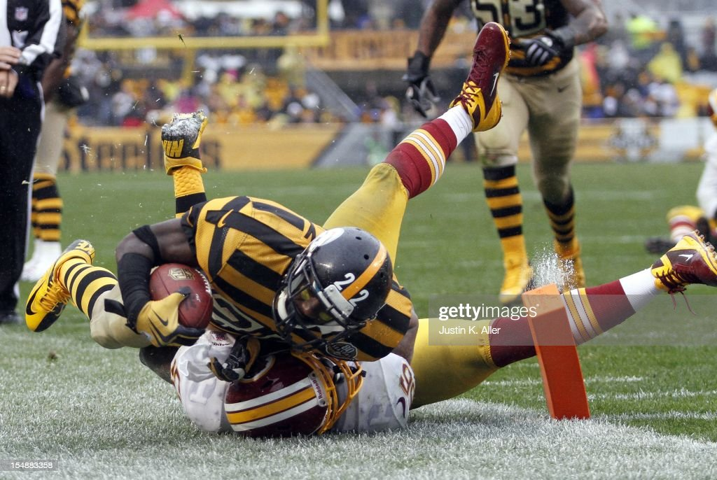Chris Rainey #22 of the Pittsburgh Steelers is tackled by Perry Riley #56 of the Washington Redskins during the game on October 28, 2012 at Heinz Field in Pittsburgh, Pennsylvania. The Steelers defeated the Redskins 27-12.