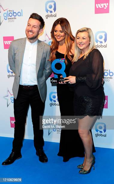 Chris Ramsey and Rosie Ramsey with the award for Best Podcast pose with Emily Atack in the Winners Room during The Global Awards 2020 at the Eventim...