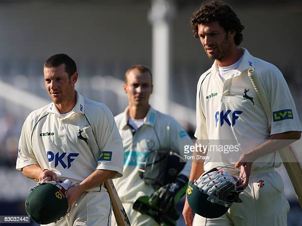 Chris Read and Charlie Shreck of Nottingham walk off after losing the match during the LV County Championship match between Nottinghamshire and...