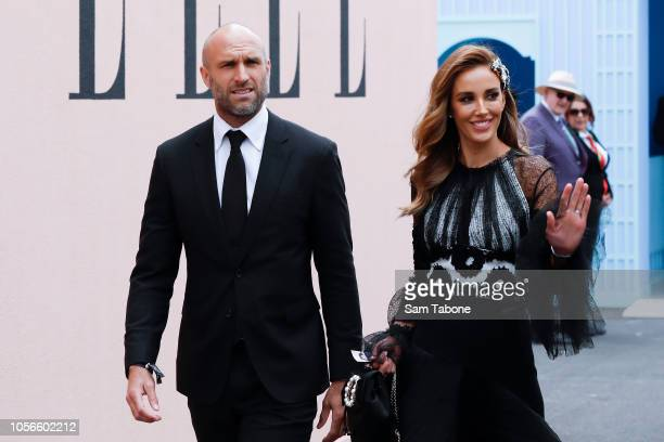 Chris Rebecca Judd arrive at the Mumm Marquee on Derby Day at Flemington Racecourse on November 3 2018 in Melbourne Australia