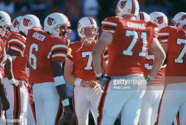 Chris Redman,Quarterback for the University of Louisville Cardinals talks with his offensive line in the huddle during the NCAA Western Athletic...