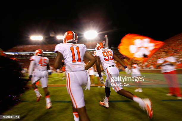 Chris Register Shadell Bell and Clelin Ferrell of the Clemson Tigers run onto the field prior to the game against the Auburn Tigers at Jordan Hare...