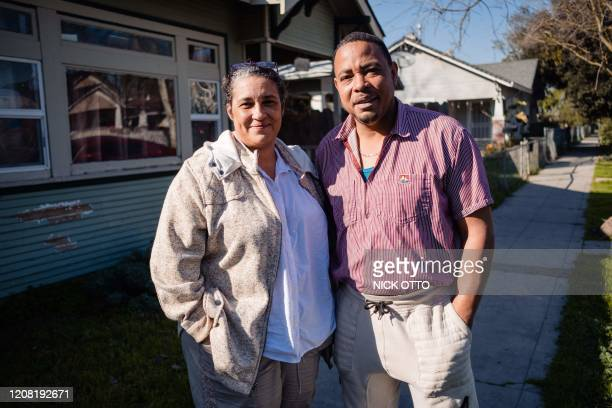 Chris Rice, a truck driver and Cheron Rice a medical assistant pose for a photo in Stockton, California on February 7, 2020. - The Rice returned to...