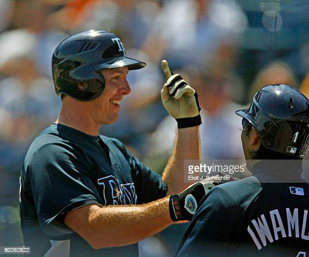 Chris Richard of the Tampa Bay Rays celebrates a home run with teammates in the dugout against the New York Yankees during a Spring Training game at...