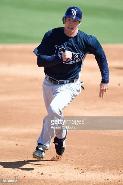 Chris Richard of the Tampa Bay Rays runs to third base during a spring training game against the St. Louis Cardinals at Roger Dean Stadium on March...