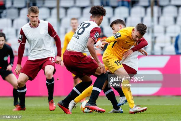 Chris Richards of Bayern Muenchen Marco Hingerl of SG Sonnenhof Grossaspach and Mert Yilmaz of Bayern Muenchen battle for the ball during the 3 Liga...