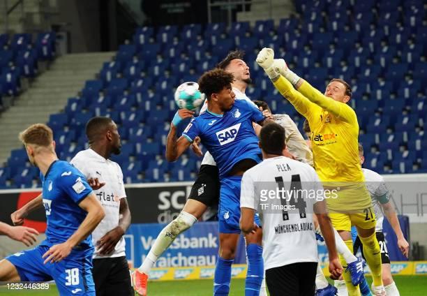 Chris Richards of TSG Hoffenheim, Ramy Bensebaini of Borussia Moenchengladbach, goalkeeper Tobias Sippel of Borussia Moenchengladbach during the...