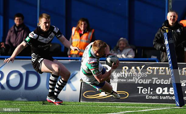 Chris Riley of the Warrington Wolves scores a try during the Super League match between Widnes Vikings and Warrington Wolves at the Stobart Stadium...