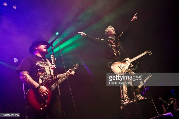 Chris Robertson and Ben Wells of the American band Black Stone Cherry performs live on stage during a concert at the Huxleys on September 6 2017 in...