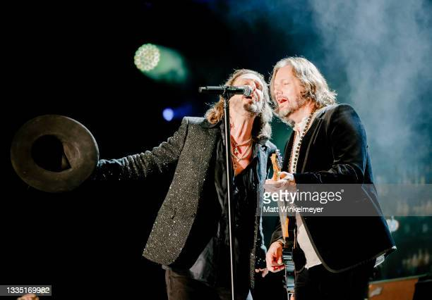 Chris Robinson and Rich Robinson of The Black Crowes perform at The Forum on August 19, 2021 in Inglewood, California.