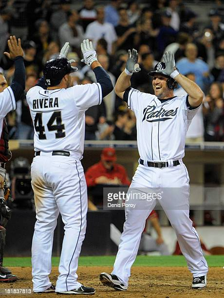 Chris Robinson of the San Diego Padres is congratulated by Rene Rivera of the San Diego Padres after he hit a threerun homer during the eighth inning...