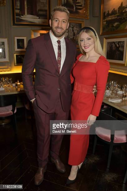 Chris Robshaw and Camilla Kerslake attend the British GQ dinner cohosted by Dylan Jones Jack Guinness in partnership with JPHackett No14 Savile Row...