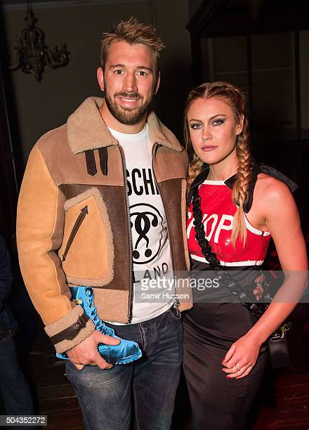 Chris Robshaw and Camilla Kerslake attend the Moschino show during The London Collections Men AW16 on January 10 2016 in London England