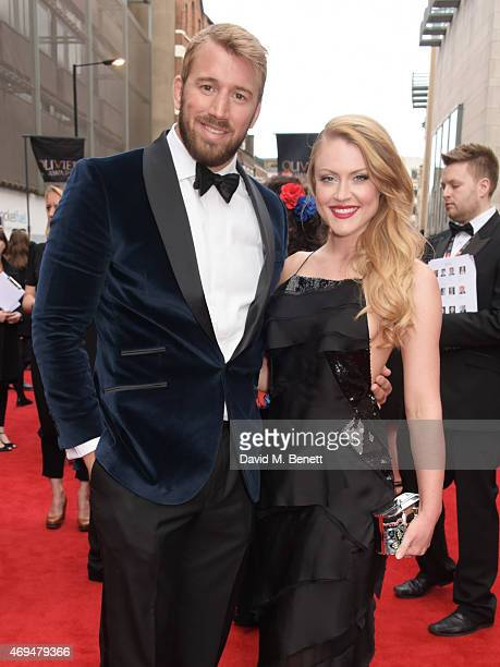 Chris Robshaw and Camilla Kerslake attend The Olivier Awards at The Royal Opera House on April 12 2015 in London England