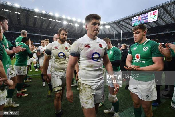Chris Robshaw and Owen Farrell of England are applauded by the Ireland team as they leave the pitch following the NatWest Six Nations match between...