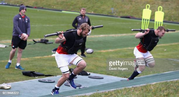 Chris Robshaw and Sam Underhill sprint carrying weights during the England training session held at Pennyhill Park on February 22 2018 in Bagshot...