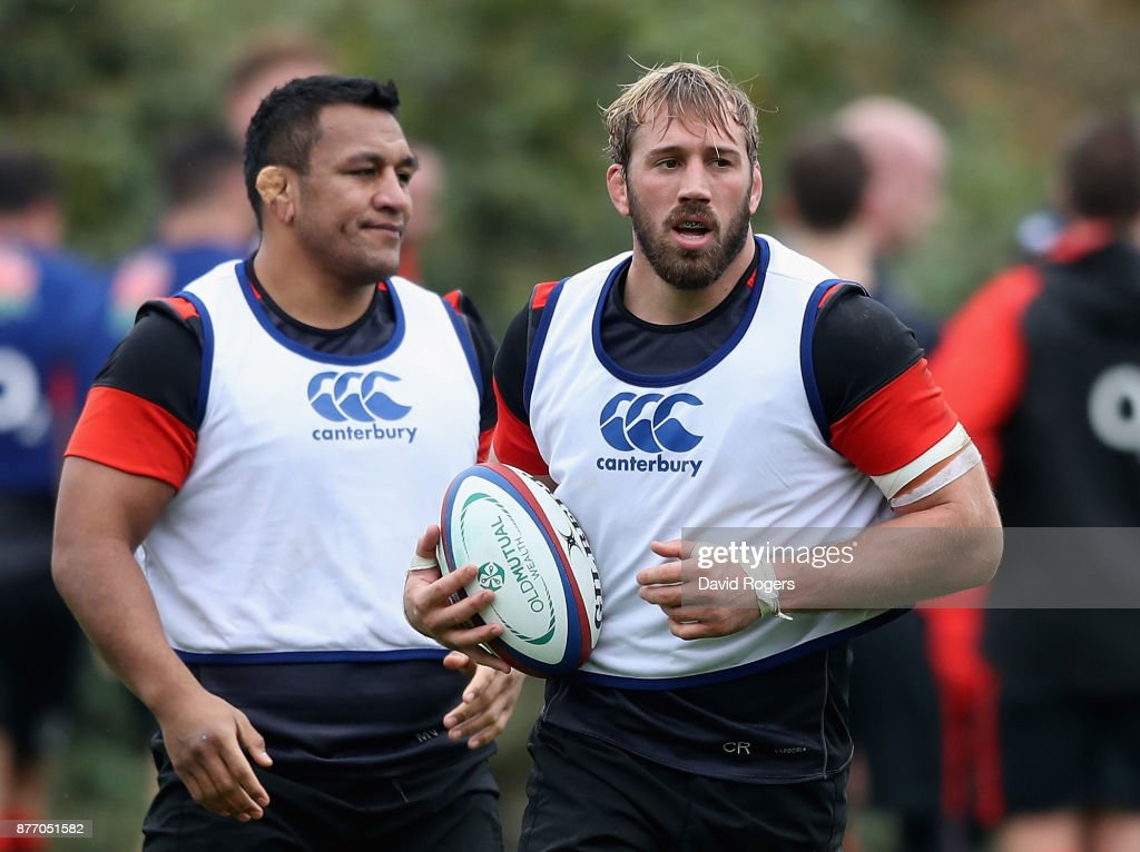 Chris Robshaw (R) looks on with team mate Mako Vunipola during the England training session held at Pennyhill Park on November 21, 2017 in Bagshot, England.