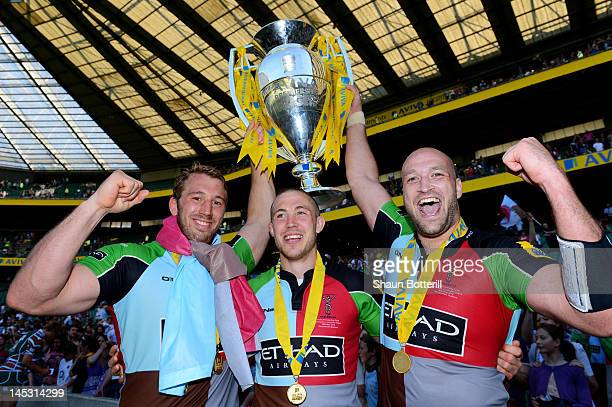 Chris Robshaw Mike Brown and George Robson celebrate with the trophy following their team's victory during the Aviva Premiership final between...