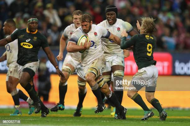 Chris Robshaw of Engand breaks away from Faf de Klerk during the third test match between South Africa and England at Newlands Stadium on June 23...