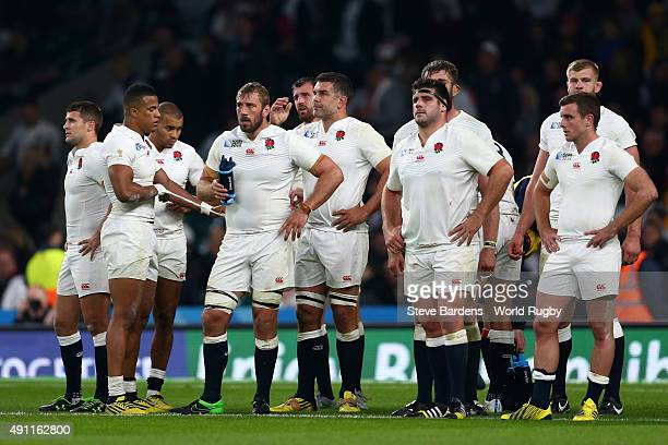Chris Robshaw of England and his team mates look dejected during the 2015 Rugby World Cup Pool A match between England and Australia at Twickenham...