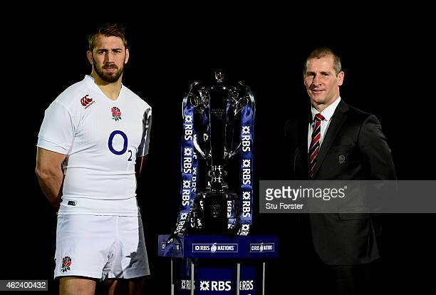 Chris Robshaw of England and Stuart Lancaster the coach of England pose with the trophy during the launch of the 2015 RBS Six Nations at the...