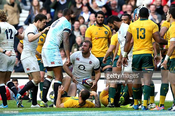 Chris Robshaw of England crashes over the tryline to score his team's first try during the QBE International match between England and Australia at...