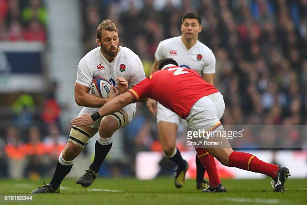 Chris Robshaw of England is tackled by Scott Baldwin of Wales during the RBS Six Nations match between England and Wales at Twickenham Stadium on...
