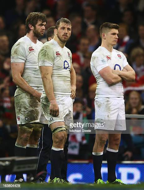 Chris Robshaw of England looks dejected with Owen Farrell and Geoff Parling after the RBS Six Nations match between Wales and England at Millennium...