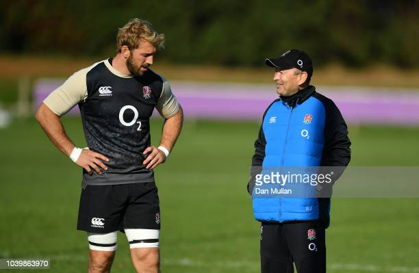 Chris Robshaw of England talks with Eddie Jones Head Coach of England during a training session at Clifton Rugby Club on September 25 2018 in Bristol...