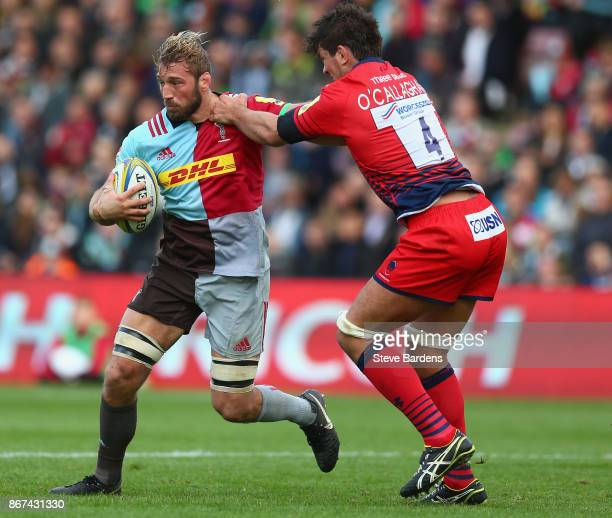 Chris Robshaw of Harlequins is tackled by Donncha O'Callaghan of Worcester Warriors during the Aviva Premiership match between Harlequins and...