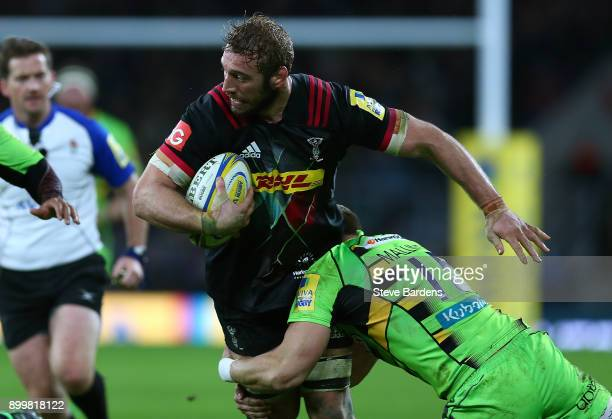 Chris Robshaw of Harlequins is tackled by Harry Mallinder of Northampton Saints during the Aviva Premiership Big Game 10 match between Harlequins and...