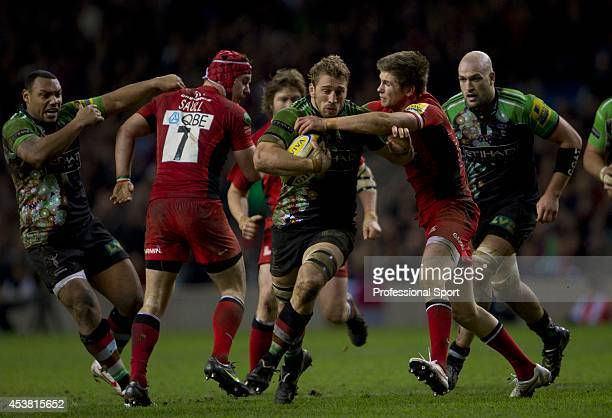 Chris Robshaw of Harlequins is tackled by Owen Farrell of Saracens during the Aviva Premiership match between Harlequins and Saracens at Twickenham...