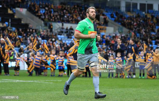 Chris Robshaw of Harlequins runs out for his 200th appearance for Harelquins during the Gallagher Premiership Rugby match between Wasps and...