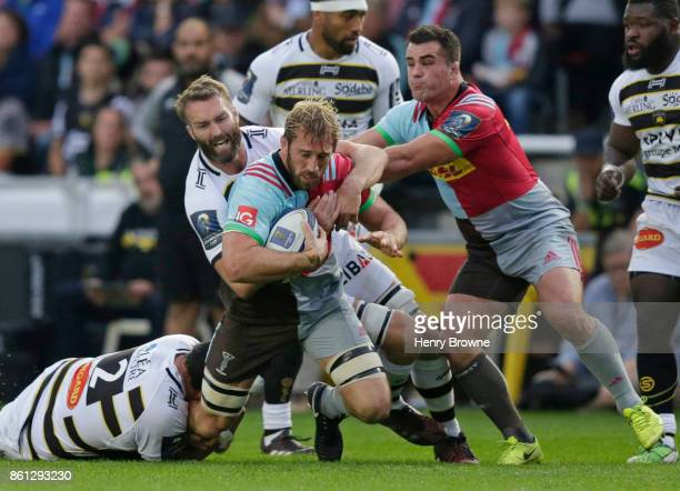 Chris Robshaw of Harlequins tackled by Hikairo Forbes of La Rochelle and Jason Eaton of La Rochelle during the European Rugby Champions Cup match...