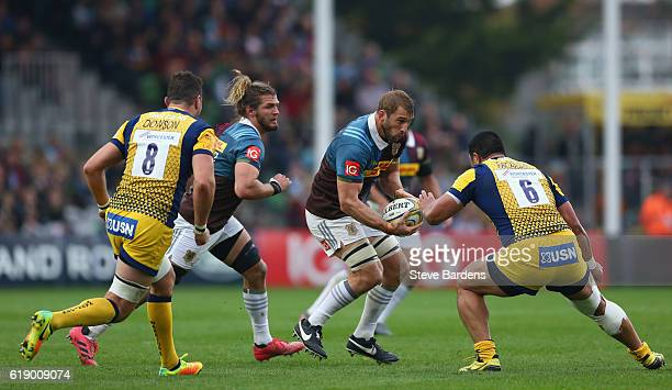 Chris Robshaw of Harlequins takes on Alafoti Faosiliva of Worcester Warriors during the Aviva Premiership match between Harlequins and Worcester...