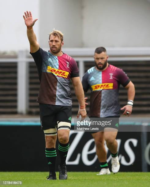 Chris Robshaw of Harlequins waves to family in the stands, as he leads his team out for the last time on his 300th Premiership appearance during the...