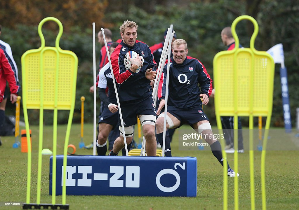 Chris Robshaw runs with the ball during the England training session held at Pennyhill Park on November 20, 2012 in Bagshot, England.