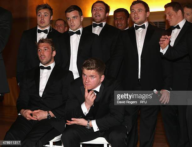 Chris Robshaw the England captain and other players watch on television the Ireland team win their match in Paris which denied England a chance of...