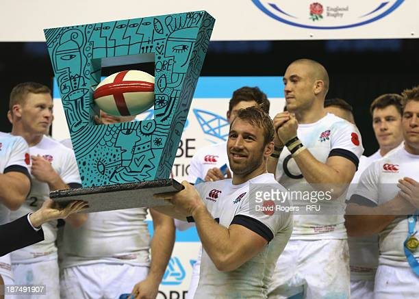 Chris Robshaw, the England captain raise the trophy after their victory during the QBE International match between England and Argentina at...