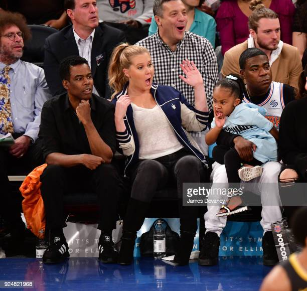 Chris Rock Amy Schumer Tracy Morgan and Maven Morgan attend the New York Knicks Vs Golden State Warriors game at Madison Square Garden on February 26...