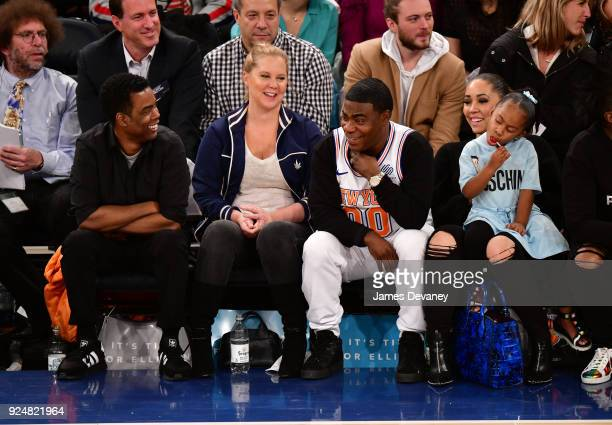 Chris Rock Amy Schumer Tracy Morgan Maven Morgan and Megan Wollover attend the New York Knicks Vs Golden State Warriors game at Madison Square Garden...