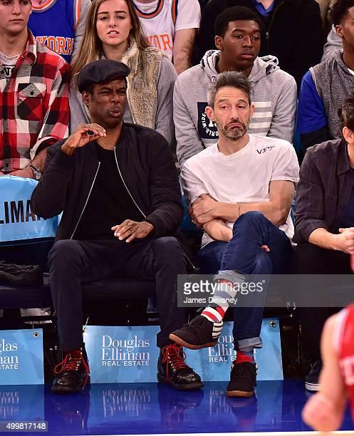 Chris Rock and Adam Horovitz attend Philadelphia 76ers vs New York Knicks game at Madison Square Garden on December 2 2015 in New York City