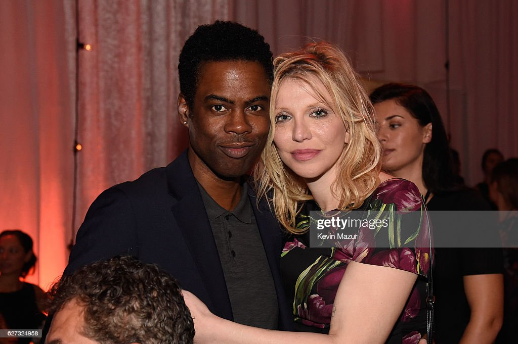 Chris Rock (L) and Courtney Love attend An Evening of Music, Art, Mischief and Performance to benefit Raising Malawi presented by Madonna at Faena Forum on December 2, 2016 in Miami Beach, Florida.