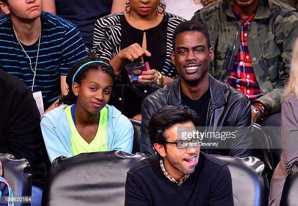 Chris Rock and daughter attend the Miami Heat vs Brooklyn Nets game at Barclays Center on November 1 2013 in the Brooklyn borough of New York City