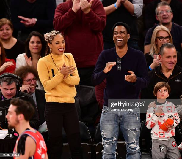 Chris Rock and guest attend the New York Knicks Vs Philadelphia 76ers game at Madison Square Garden on December 25 2017 in New York City