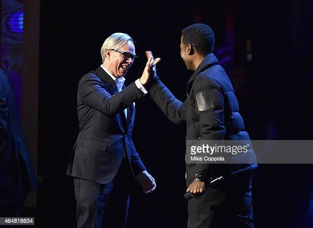 Chris Rock and Tommy Hilfiger perform onstage at Comedy Central Night Of Too Many Stars at Beacon Theatre on February 28 2015 in New York City