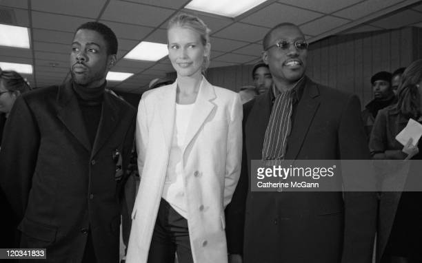Chris Rock Claudia Schiffer and Wesley Snipes pose for a photo backstage at the VH1 Fashion Awards in October 1998 in New York City New York